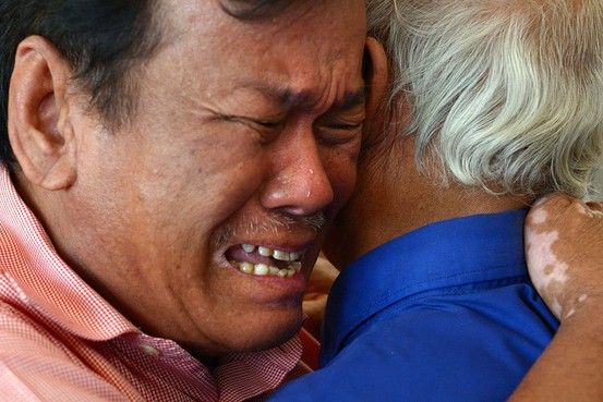 "For the record, I didn't take this photo. I was Colorado. This is what the WSJ says, though: ""Soum Rithy, a Cambodian survivor of the Khmer Rouge, cries as he hugs Chum Mey, a survivor of Tuol Sleng prison, after hearing the verdict in the trial of two former Khmer Rouge leaders on Thursday. Agence France-Presse/Getty Images"""